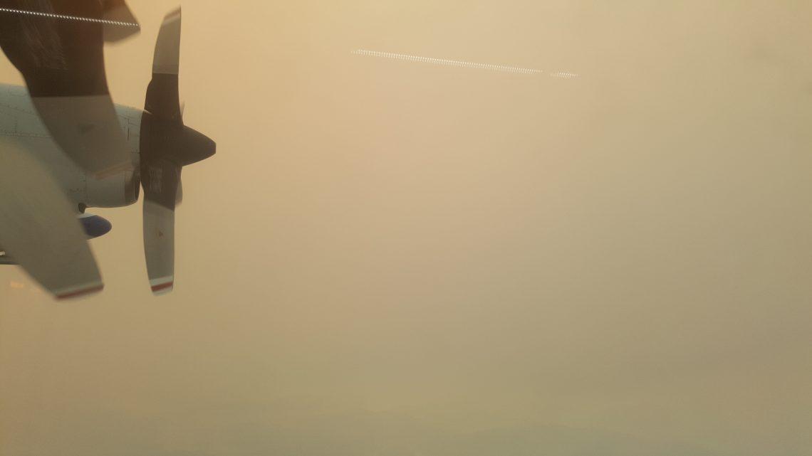 Research aircraft flies through smoke.