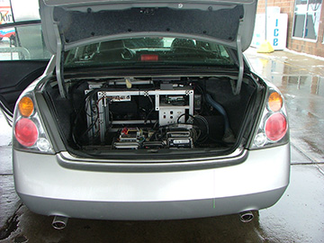 Photograph of open car trunk showing scientif equipment