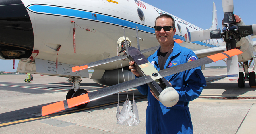 NOAA scientist Joe Cione holding Coyote drone​   ​