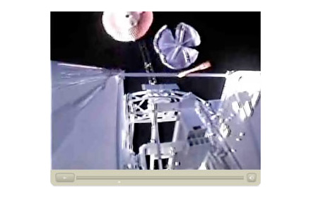Two parachutes attache to equipment in space