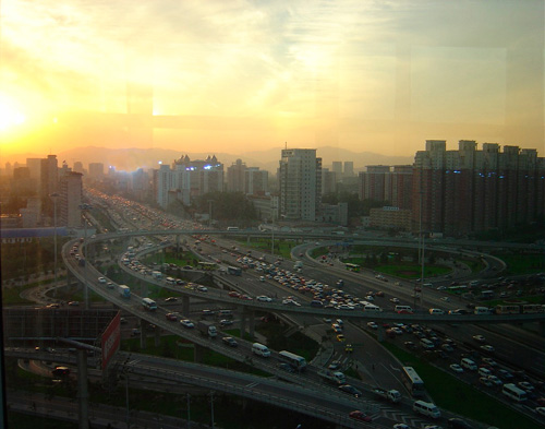 Photograph of a sunset over a city and highways