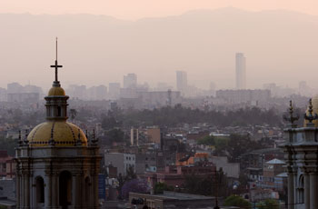 Photograph of polluted, pinkish-gray air over city-scape