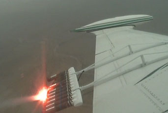 Wing of an airplane with flares mouted behind it