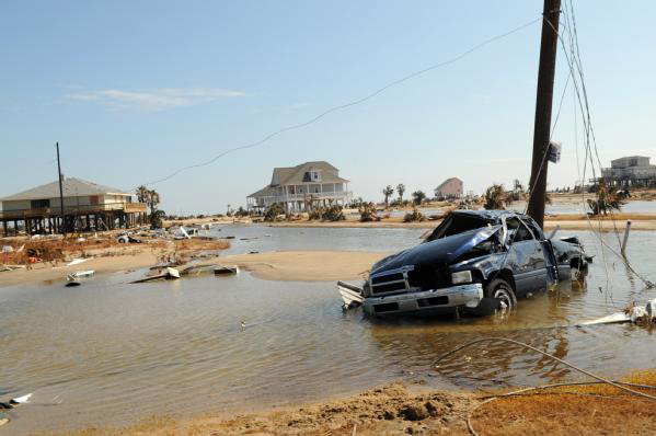 Damaged cars and homes on the Bolivar Peninsula, Texas, after Hurricane Ike