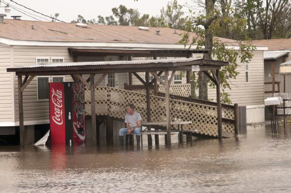 Man stranded on porch of house by floodwater from Hurricane isaac