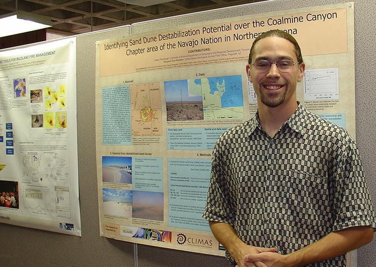 Casey Thornbrugh in front of science conference poster