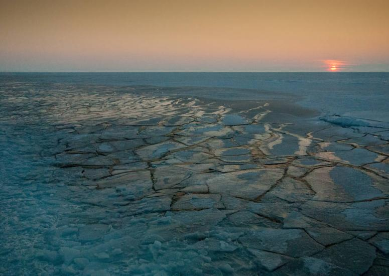Sun setting on Arctic sea ice pack