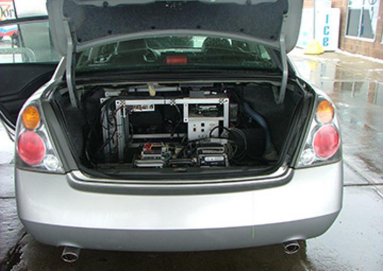 Photograph of open car trunk showing scientif equipment