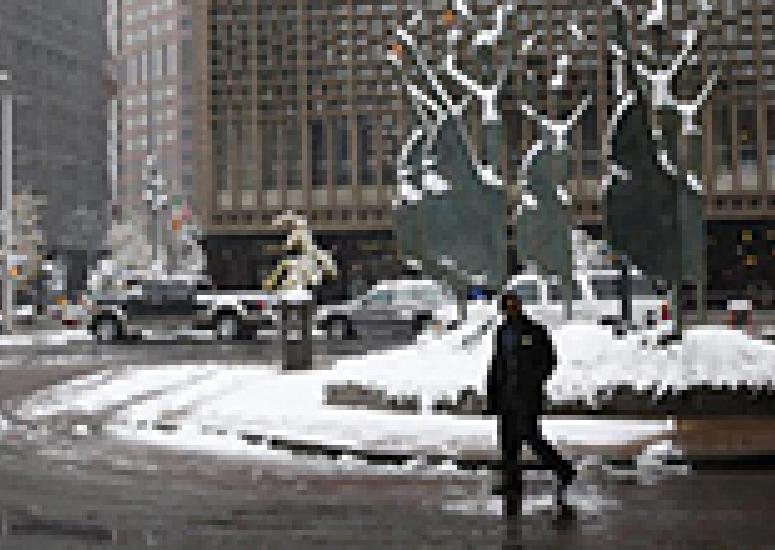 Man walking on snowy city street