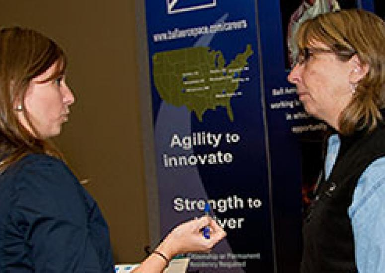 Two women discuss employment possibilities at Veterans Job Fair