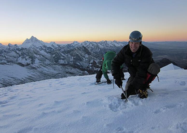 Andean glacier melt - NCAR scientist Carl Schmitt on a Peruvian glacier.