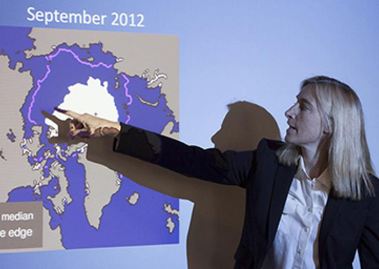 Photo of NCAR scientist Marika Holland explaining changes in Arctic sea ice extent