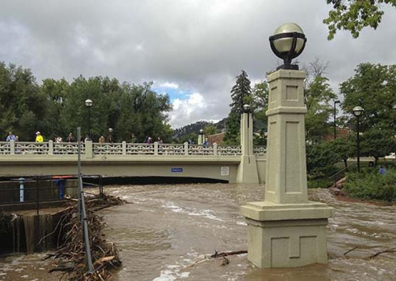 Engineering for Disaster. Photo: bicycle path channels floodwaters during 2013 storm, Boulder, CO