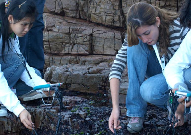 Students in the GLOBE program test water salinity at a tide pool off the Cape of Good Hope in South Africa.