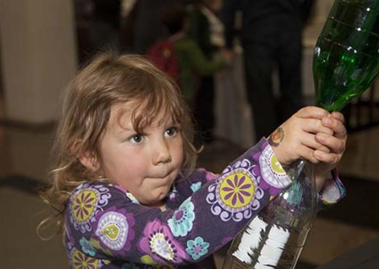 Super Science Saturday: young girl participating in a science experiment