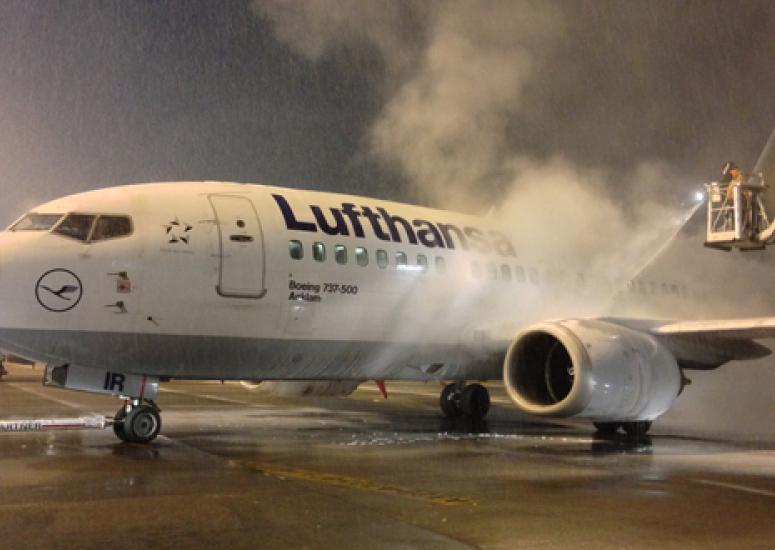 Picture of a plane getting deiced on the runway