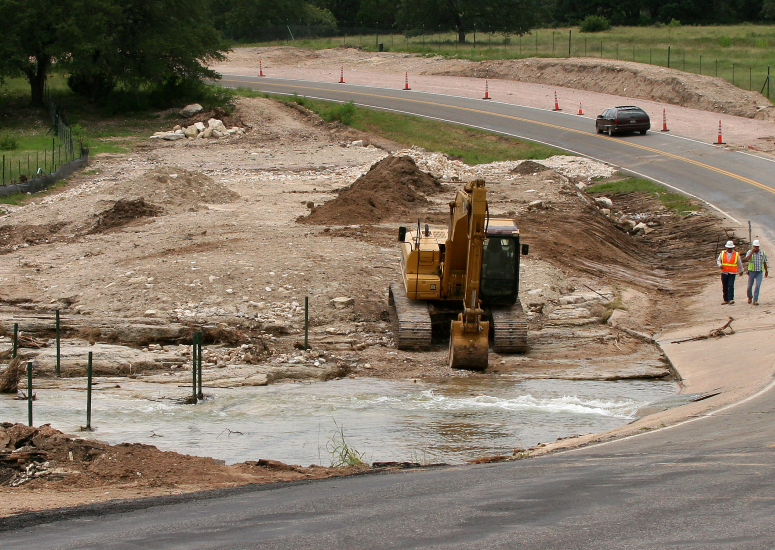 Constructing roads for climate: flooded road in Texas